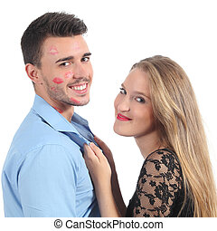 Woman grabbing a man with a lot of lipstick shapes isolated...