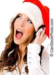 sidepose of christmas woman listening music - side pose of...