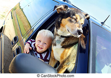 Happy Baby and Dog in Minivan Window - a cute, smiling baby...