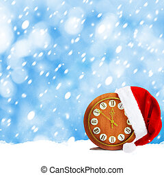 Santa Claus hat and watch Christmas snowy night