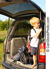 Child Waiting in Van to Leave for Vacation - a young child...