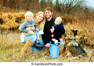 Happy Family by River in Late Autum - A happy family of four...