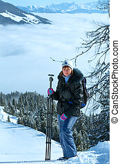 Woman - photographer and cloudy winter mountain landscape -...