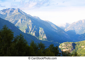 Mountains peaks with snow in summer