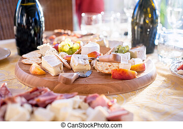 Cheese and fruits as appetizer with various types of cheese...