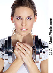 young woman with dumbbell