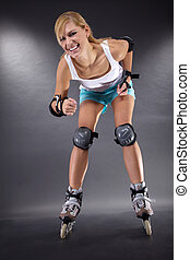 young woman moves inline skate