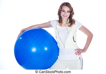 young woman doing sports with ball