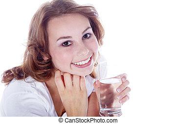 girl in sport drinks water