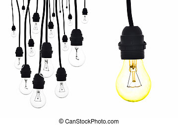 A yellow light bulb hanging next to a number of lamps - A...