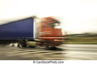 Truck speeding on freeway with blurred motion - Truck...