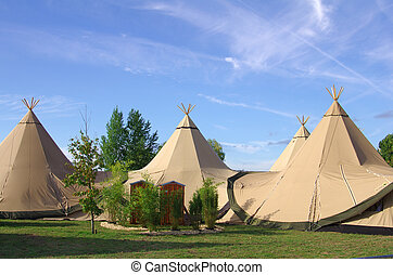 Tipis - A group of traditional tipis in the nature
