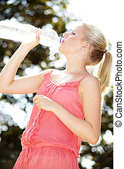 woman drinking water outdoors - pretty woman drinking water...