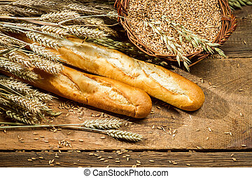 Baguettes and a basket full of grain with ears
