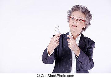 old woman with energy saving bulb