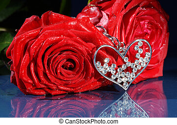 red rose with jewelry heart