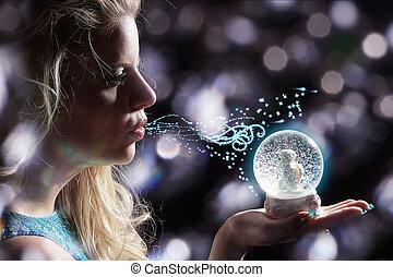 pretty woman with snow globe