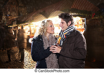 Young couple drinks mulled wine