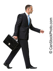 Profile of walking with case business man - Profile of...