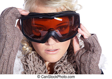 Pretty woman with snow goggles