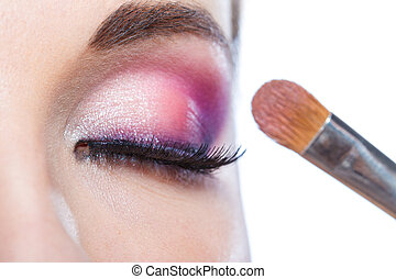 Close up of girl with closed eye applying makeup - Close up...