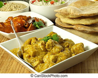 Chicken in curry - Chicken pieces in indian curry spices,...