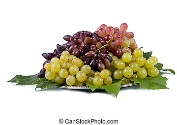 Variety of fresh grape cultivars represented on a plate...