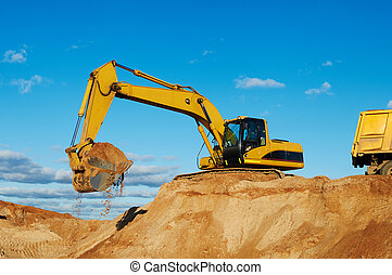 excavator loading tipper dumper - excavator machine loading...