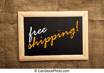 Free shipping note on black notice board