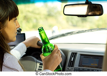 Drunken female driver - Closeup view from behind of a...