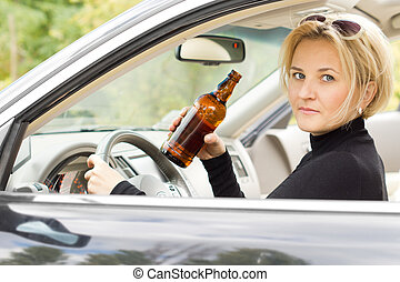 Intoxicated woman driver looking out of her side window with...