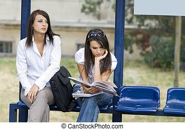 women at bus stop - business woman in the morning wating for...
