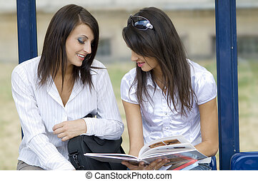 women waiting and chatting - young women talking togheter...