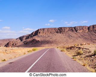 Desert Road in Morocco - Straight road through the desert in...