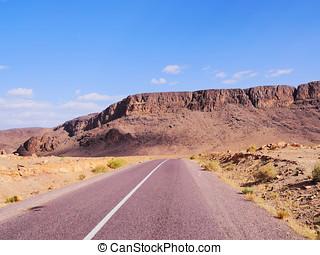 Desert Road in Morocco - Straight road through the desert in...
