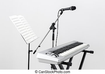 Electric piano, microphone and music stand