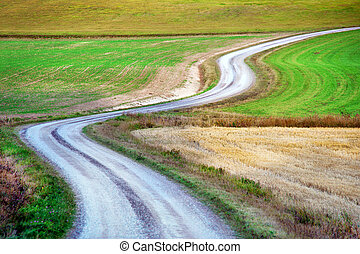 winding country road in rural area in early fall