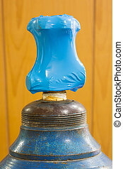 Sealed - Close up sealed gas cylinder valve with blue color...