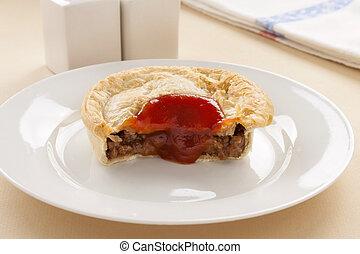 Half Eaten Meat Pie - Half eaten meat pie with ketchup...