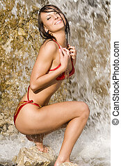 so hot - cute brunette in red bikini playing with water near...