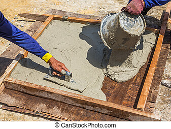 Cement slab cast - Worker do cement slab cast in wooden...