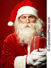 Winking - Photo of funny Santa Claus with one eye closed...