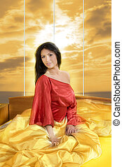 woman in red - sensual brunette with red nightgown posing in...
