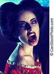 vampire fangs - Close-up portrait of a bloodthirsty female...