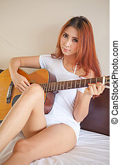 Sexy girl with a guitar