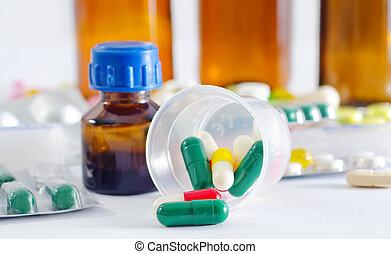 color pills and medical bottle