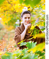 woman in autumn park - Portrait of beauty woman in autumn...