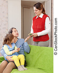 mother leaving baby with nanny at home. Focus on adults