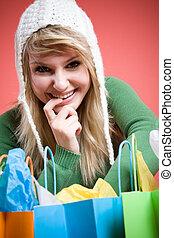 Shopping caucasian girl - A beautiful happy caucasian girl...