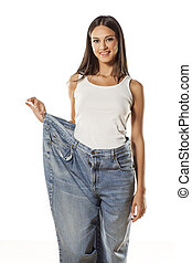 my old huge pants - happy pretty attractive girl posing in...